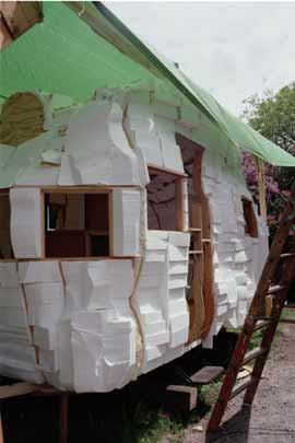 Process image of trailer with windows,the walls made of stryfoam blocks.