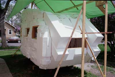 Process image of rear of trailer with windows,the walls made of stryfoam blocks.