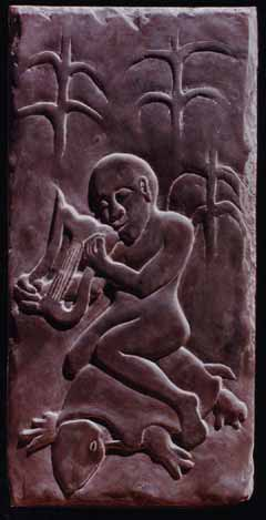 Image of carving on roofing slate of a lyre player riding the back of a tortoise.