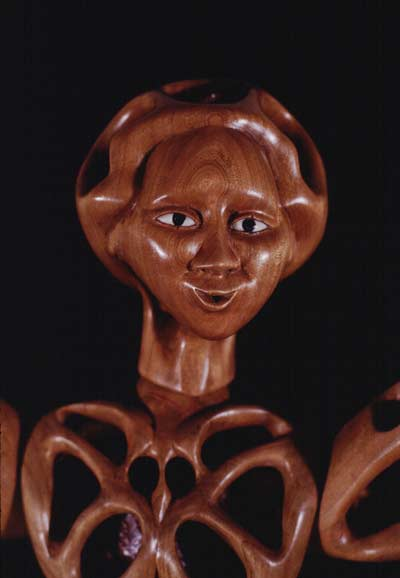 Image of perforated wooden doll's head.